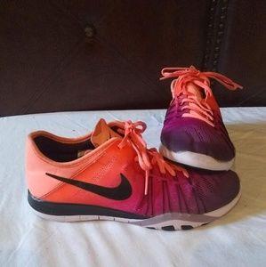 Woman's Nike low top free 5.0  peach  , purple's!